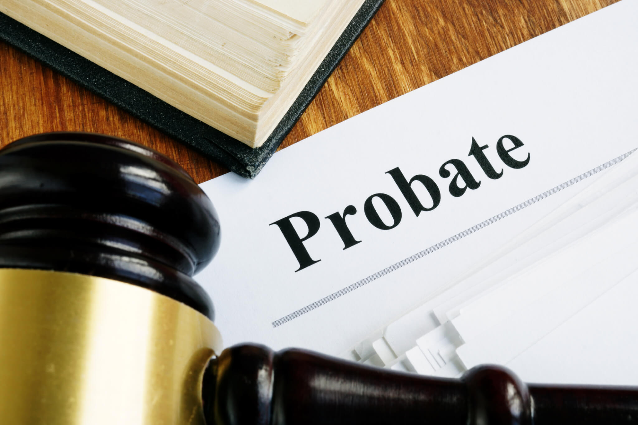 Probate sign, stack of papers and gavel.